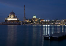 Mosque. Night scene of a mosque bright lights reflected on the river Royalty Free Stock Image