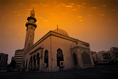 Mosque. Under an orange sky at sunset Royalty Free Stock Photo