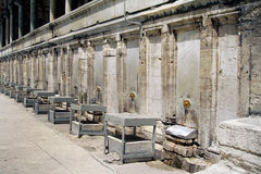 Mosque ablution facilities. A row of ablution fountains attached to a mosque wall in Istanbul, Turkey Stock Photo