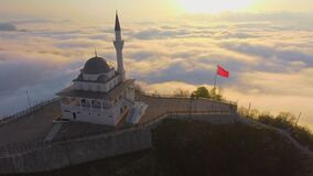Mosque above clouds over
