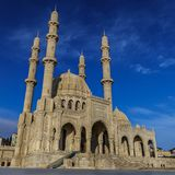 Mosque in Baku, Azerbaijan. Mosque against a blue sky with clouds royalty free stock photos