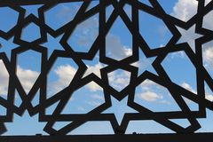MOSQUE AL-ALAM KENDARI, INDONESIA. ORNAMENT VENTILATION FORM OF STARS,VENTILATION ORGANIZATION FORM OF STARS LOOKING AT A BLUE SKY IN GENDER KENDARI stock image