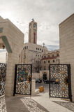 Mosque in Amman. King Abdullah I , on a cloudy day. It´s a vertical picture. It´s a editoral picture with orthodox church in the background royalty free stock photos