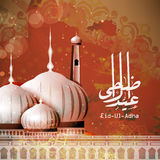 Mosque with Arabic text for Eid-Ul-Adha. Glossy Mosque with Arabic Islamic calligraphy of text Eid-Ul-Adha on stylish floral design decorated background for Royalty Free Stock Images