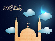 Mosque and Arabic text for Ramadan Kareem. Creative Mosque and Arabic Islamic Calligraphy of text Ramadan Kareem on cloudy night background Royalty Free Stock Photo