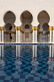 Mosque arches reflected Stock Photos