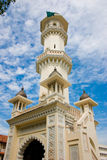 Mosque architecture. Impressive mosque tower architecture with blue sky white clouds Royalty Free Stock Photo