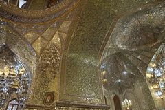 Mosque. Architecture details in the mirrors room at the Shah Cheragh Mosque, Shiraz, Iran. The place is a funeral monument and mosque, housing the tombs of royalty free stock photography
