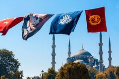 The mosque and Ataturk. ISTANBUL, TURKEY - September 25, 2012: The flag of Ataturk flutters on a wire in front of the famous Blue Mosque. Mustafa Kemal Ataturk ( Stock Photo