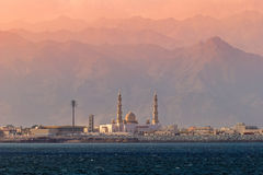 Mosque on the background of mountains at sunset. Dibba. United A Royalty Free Stock Image