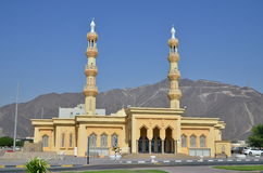 Mosque. With a background of rocky mountain at Fujairah stock photos
