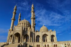 Mosque in Baku, Azerbaijan. Mosque against a blue sky with clouds stock photo