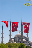 Mosque behind turkish flags Royalty Free Stock Photo