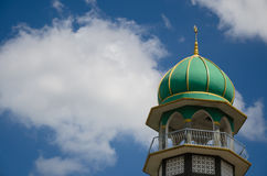Mosque In Blue Sky. The top of Azan tower is a part of mosque is distinct and appearing in the blue sky Royalty Free Stock Photos