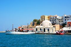 Mosque and boats in the harbour, Chania. Royalty Free Stock Images