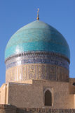 Mosque in Bukhara. Blue dome of mosque and blue sky Royalty Free Stock Photos
