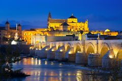 Mosque-cathedral of Cordoba and Roman bridge in night Stock Photo