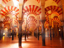 Mosque-Cathedral of Cordoba, Spain. Arabic arches hallway in Corodoba's mosque. Spain Royalty Free Stock Image