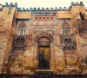 The Mosque Cathedral in Cordoba, Spain. Exterior wall with great door - famous landmark in Andalusia Stock Photography