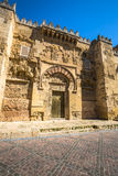 The Mosque Cathedral in Cordoba, Spain. Exterior wall with great. Door - famous landmark in Andalusia Royalty Free Stock Photo