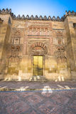 The Mosque Cathedral in Cordoba, Spain. Exterior wall with great. Door - famous landmark in Andalusia Royalty Free Stock Image