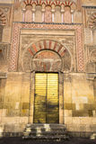 The Mosque Cathedral in Cordoba, Spain. Exterior wall with great. Door - famous landmark in Andalusia Stock Photography