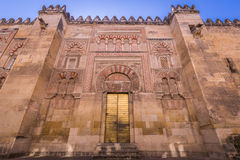 The Mosque Cathedral in Cordoba, Spain. Exterior wall with great. Door - famous landmark in Andalusia Stock Image
