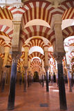Mosque-cathedral of Cordoba, Spain. Striped arches hall in Cordoba's mosque. Spain Stock Photos