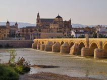 Mosque-Cathedral and the Roman Bridge in Cordoba, Spain Royalty Free Stock Photos