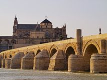 Mosque-Cathedral and the Roman Bridge in Cordoba, Spain Stock Photo