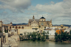 Mosque Cathedral and Roman Bridge in Cordoba, Spain Royalty Free Stock Photography