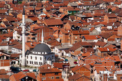 Mosque in the city of Prizren, Kosovo. A white mosque between the red houses in the city of Prizren in Kosovo Stock Photo