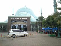 Mosque in the city of Tangerang, Indonesia. There is a white car that is walking towards the parking area royalty free stock photos