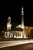 Mosque and clock tower in Tirana. Et'hem Bey Mosque (built 1789-1823) and clock tower (built in 1820s) on Skanderbeg Square, central Tirana, Albania royalty free stock photo