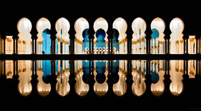 Mosque columns reflecting in the water at night Stock Image