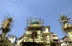 Mosque in construction. Man working on a mosque in construction at Mohamedali Road, Mumbai, India Stock Photos