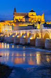 Mosque of Cordoba and Roman bridge in night Stock Photo