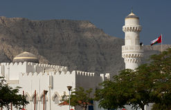 Mosque with dome and minaret. And the flag of Oman, Khasab, Musandam, Sultanate of Oman royalty free stock photo