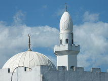 A mosque dome and turret Royalty Free Stock Images
