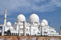Mosque,domes and a minaret. Grand mosque in Abu Dhabi in early summer Stock Photography
