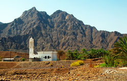 Mosque the Dubai Desert. A beautiful mosque in the Desert with mountains in the background royalty free stock images