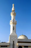 Mosque the Dubai Desert. A beautiful mosque with birds sitting on the dome Stock Photo