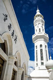 Mosque entrance. White minaret with blue sky Stock Photo