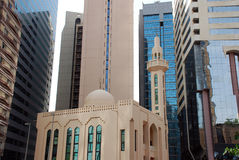 Mosque in front of modern buildings Stock Photos