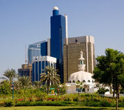 Mosque in front of office buildings in Abu Dhabi. Group of office skyscrapers in Abu Dhabi with a small mosque in the foreground royalty free stock photo