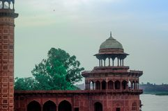 Fort in front of the Taj Mahal In Agra. The mosque in front of the Taj Mahal. The Jama Masjid mosque is a sandstone fort with mughal architecture with arched Stock Photos