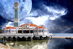 Mosque with Galactic Background. A beautiful mosque on stilts by the sea at Tanjong Bunga, Penang, Malaysia with stars and galaxies Royalty Free Stock Images