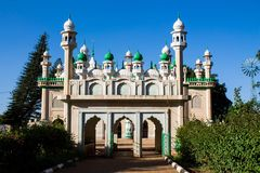 Mosque with green domes and minaret towers. Mosque green domes and minaret towers. Muslim religion traditional architecture buildingwith minara Royalty Free Stock Image