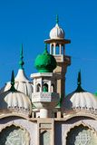 Mosque green domes and minaret towers. Muslim religion traditional architecture buildingwith minara Royalty Free Stock Photography