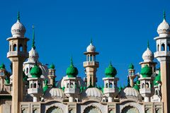 Mosque green domes and minaret towers. Muslim religion traditional architecture buildingwith minara Royalty Free Stock Photos